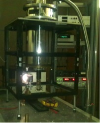 Liquid-nitrogen cryostat for VIS-UV optical transmission and photoluminescence.